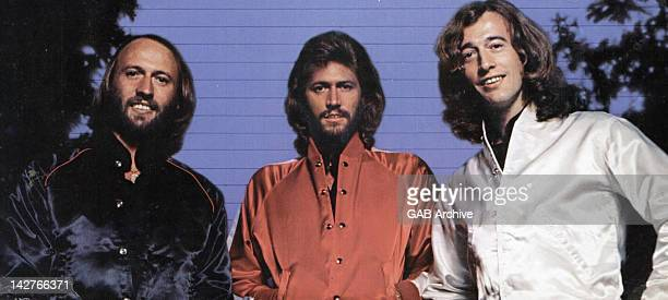 Photo of The Bee Gees posed circa 1975 Left to right Maurice Gibb Barry Gibb and Robin Gibb