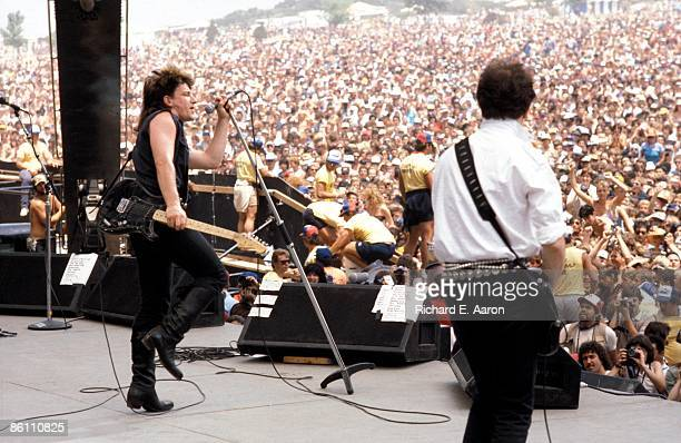 Photo of THE EDGE and BONO and U2 Bono and The Edge performing live onstage at the US Festival in San Bernardino showing crowds in front of stage