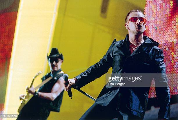 Photo of THE EDGE and BONO and U2 Bono The Edge performing live onstage on first date of PopMart tour