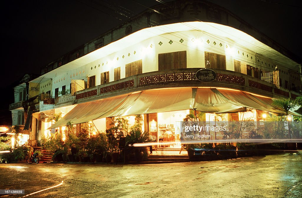 Photo of the front of l'Elephant Restaurant in Luang Prabang by night. The small, remote town has a number of fine French eateries..