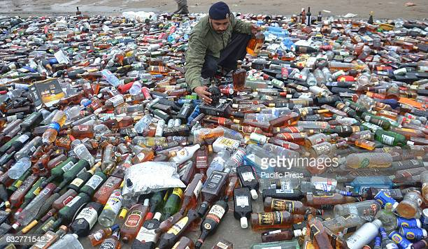 A photo of the glass containers of liquors Customs officials burn piles of drugs on International Customs Day Pakistani customs officials destroyed...