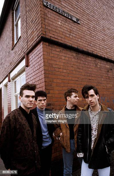 Photo of The Smiths and Andy ROURKE and Johnny MARR and Mike JOYCE and MORRISSEY LR Morrissey Mike Joyce Andy Rourke Johnny Marr posed group shot in...