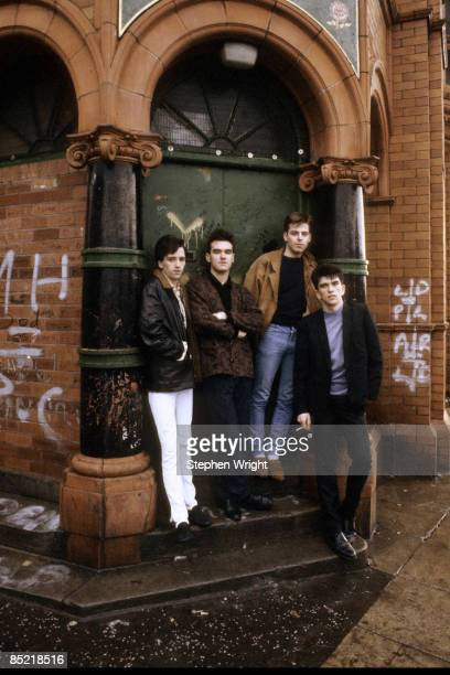 Photo of The Smiths and Andy ROURKE and Mike JOYCE and MORRISSEY and Johnny MARR LR Johnny Marr Morrissey Andy Rourke Mike Joyce posed group shot...