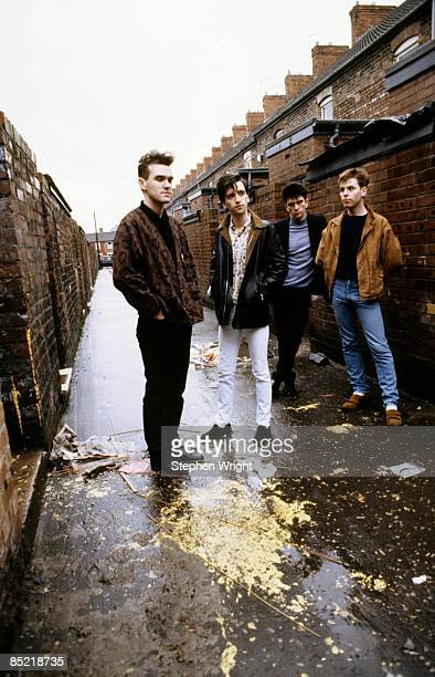 Photo of The Smiths and Andy ROURKE and Mike JOYCE and MORRISSEY and Johnny MARR LR Morrissey Johnny Marr Mike Joyce Andy Rourke posed group shot in...