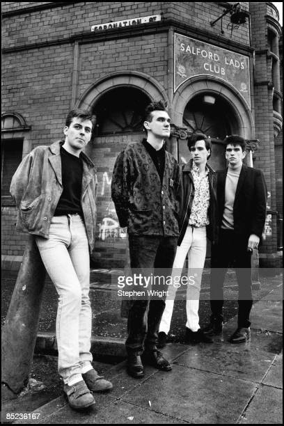 Photo of The Smiths and Mike JOYCE and Johnny MARR and Andy ROURKE and MORRISSEY LR Andy Rourke Morrissey Johnny Marr Mike Joyce posed group shot...