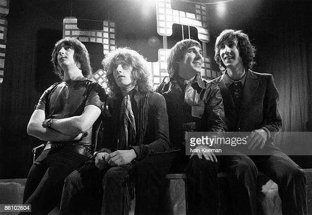 John Entwistle Roger Daltrey Keith Moon Pete Townshend Posed group shot Sitting on the edge of the stage