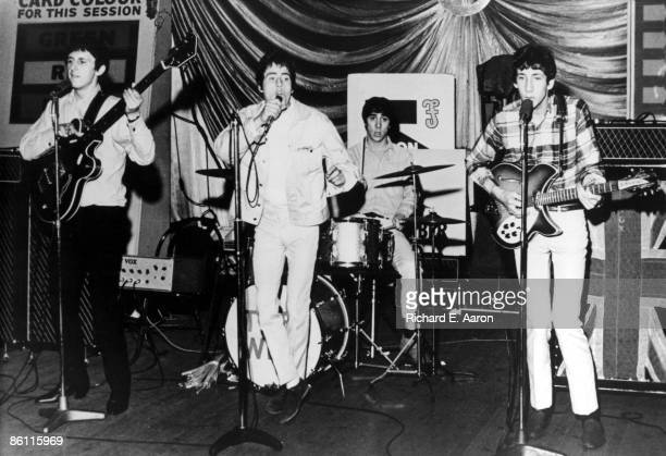 Photo of The Who LR John Entwistle Roger Daltrey Keith Moon Pete Townshend performing live onstage