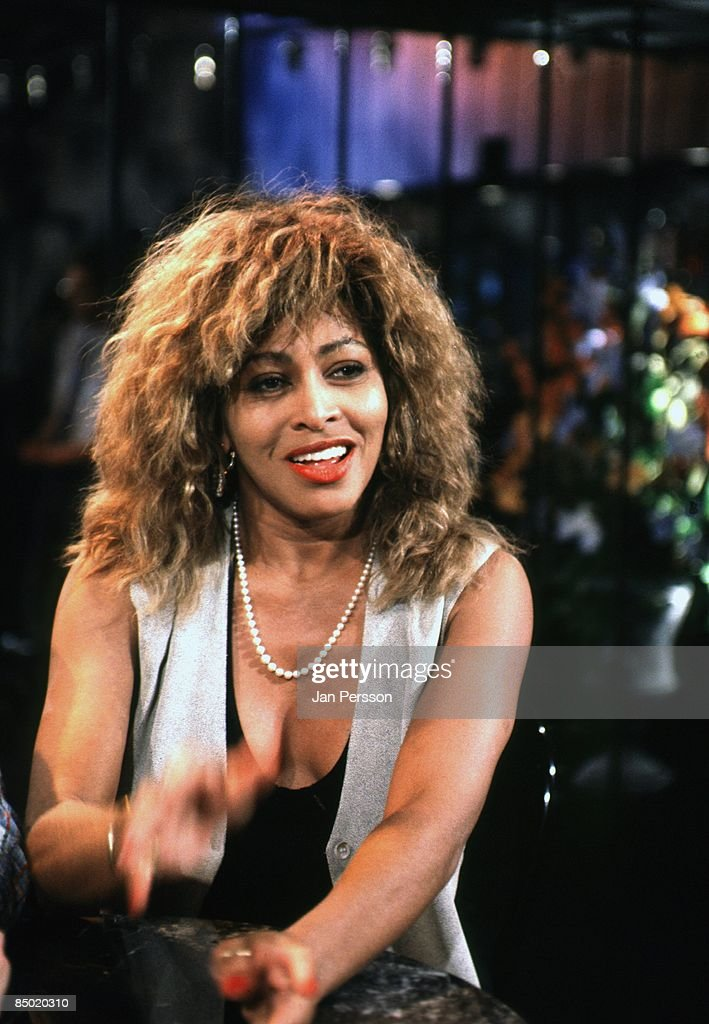 Photo of Tina TURNER; posed, being interviewed