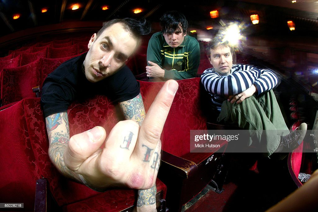 Photo of Tom DELONGE and BLINK 182 and Mark HOPPUS and Travis BARKER Posed group portrait