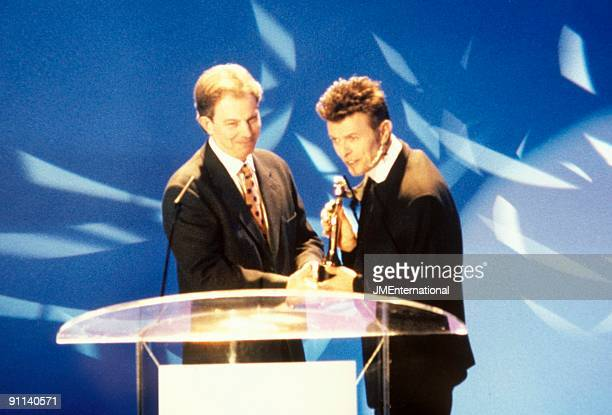 AWARDS Photo of Tony BLAIR and David BOWIE with Tony Blair onstage receiving award at ceremony