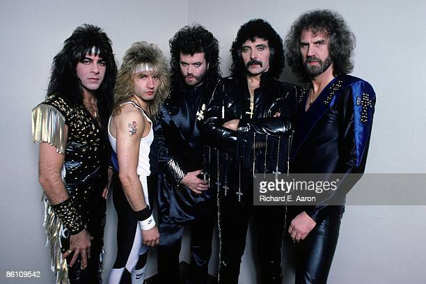 Photo of Tony IOMMI and Glenn HUGHES and BLACK SABBATH LR Dave Spitz Eric Singer Glenn Hughes Tony Iommi Geoff Nicholls posed studio group shot