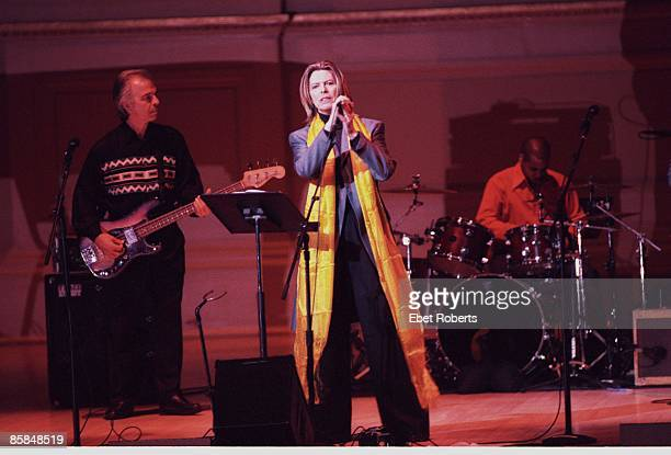 Photo of Tony VISCONTI and David BOWIE with Tony Visconti performing live onstage at Tibetan Freedom Concert