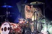 Photo of Travis BARKER and BLINK 182 Drummer Travis Barker performing on stage