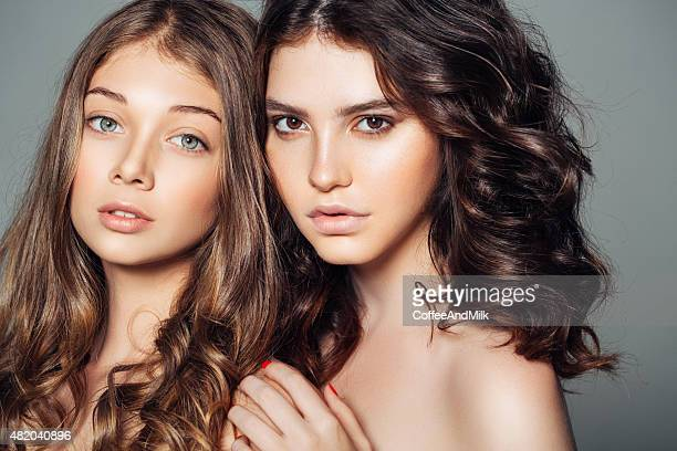 Photo of two beautiful girls on a white background