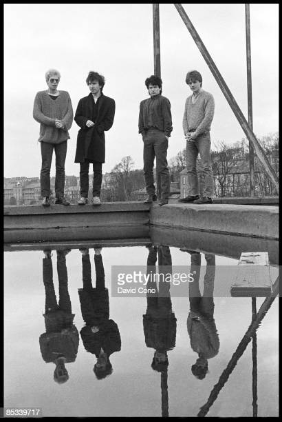 CLUB Photo of U2 and Larry MULLEN JNR and Adam CLAYTON and BONO and THE EDGE Group portrait on hotel roof LR Adam Clayton The Edge Bono and Larry...