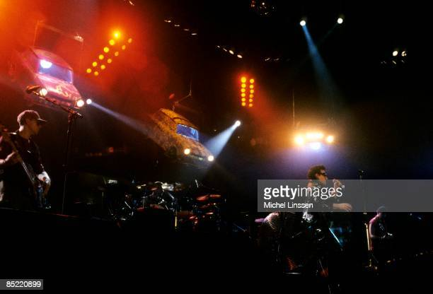AHOY Photo of U2 LR Adam Clayton Larry Mullen Jnr Bono and The Edge performing live onstage on Zoo TV tour showing stage set and Trabant cars IMAGE...