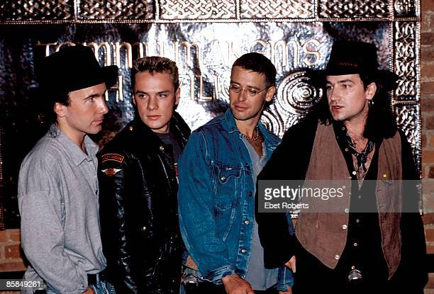Photo of U2 LR The Edge Larry Mullen Jnr Adam Clayton Bono posed group shot Joshua Tree press conference