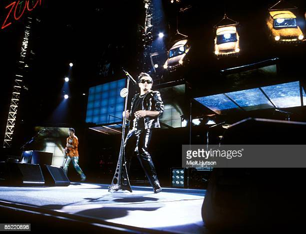 STADIUM Photo of U2 performing live onstage on Zoo TV Zooropa tour showing stage set and Trabant cars