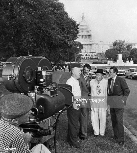 Photo of US director Otto Preminger chatting with actors Don Murray Charles Laughton and Walter Pidgeon taken during the shooting of the film Advise...