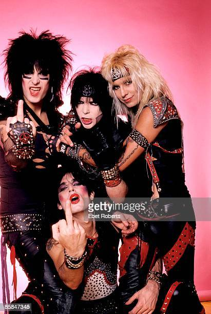 Photo of Vince NEIL and MOTLEY CRUE and Tommy LEE and Nikki SIXX and Mick MARS Posed group shot studio L R Nikki Sixx Tommy Lee Mick MarsVince Neil
