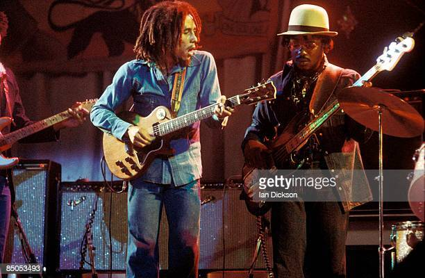 BIRMINGHAM Photo of WAILERS and Aston BARRETT and Bob MARLEY Bob Marley performing live on stage at the Odeon with Aston 'Family Man' Barrett