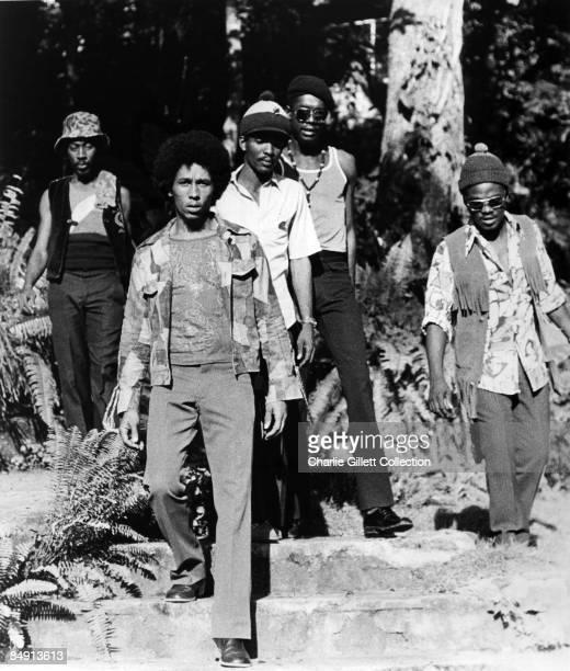 Photo of WAILERS and Bob MARLEY LR Bunny Wailer Bob Marley Carlton Barrett Peter Tosh Aston 'Family Man' Barrett The Wailers posed group shot