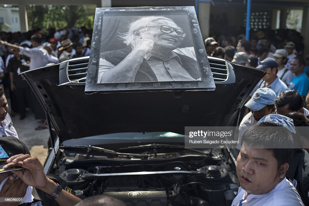 A photo of Win Tin is placed on the funeral car where his body was carried during his funeral service in Yay Way cemetery on April 23, 2014 in Yangon, Burma. The Burmese journalist who helped Aung San Suu Kyi launch a pro-democracy movement against the junta military regime, died April 21 in Rangoon.