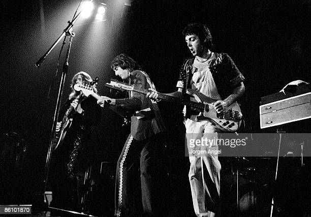 Photo of WINGS and Henry MCCULLOUGH and Denny LAINE and Paul McCARTNEY L R Henry McCullough Denny Laine Paul McCartney Wings Performing live onstage