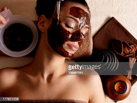 Photo of woman at a spa wearing a mud mask and relaxing : Stock Photo