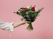Photo of woman holding beautiful bouquet of flowers roses pink background