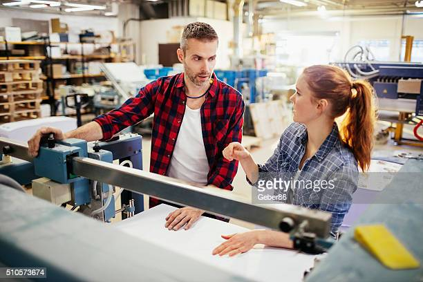 Photo of workers in printing factory