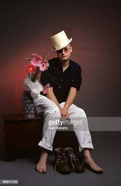 Photo of XTC and Andy PARTRIDGE Posed studio portrait of Andy Partridge flowers hat