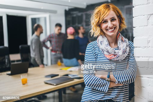 Photo of young business woman in a conference room : Stock Photo