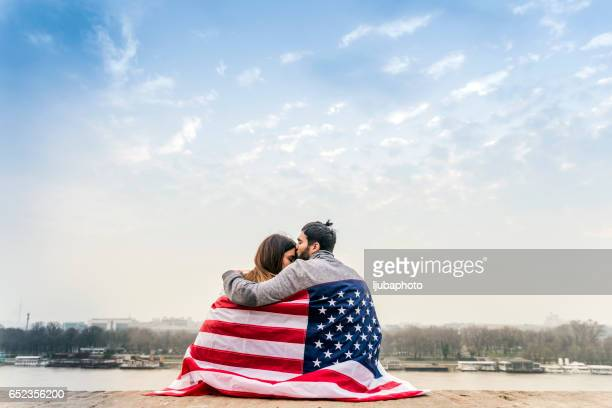Photo of Young couple with American flag
