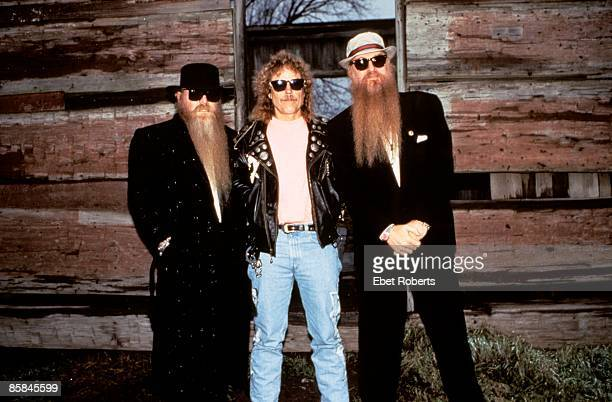 Photo of ZZ TOP and Frank BEARD and Dusty HILL and Billy GIBBONS LR Dusty Hill Frank Beard Billy Gibbons posed group shot