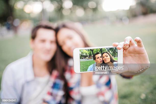 Photo on display of a smartphone of young couple in love