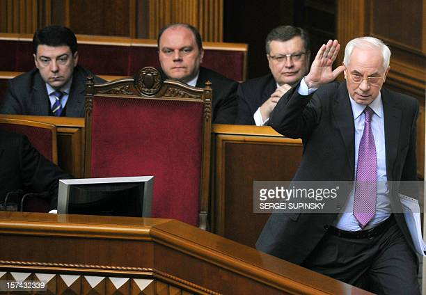Photo on March 16 shows Ukrainian Prime Minister Mykola Azarov who waves his hand in front of the ministers of his cabinet as he leaves the...