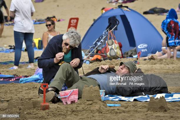 Photo People relax on Croyde beach Devon where the UK National Sandcastle competition is being held to raise money for North Devon Hospice which...