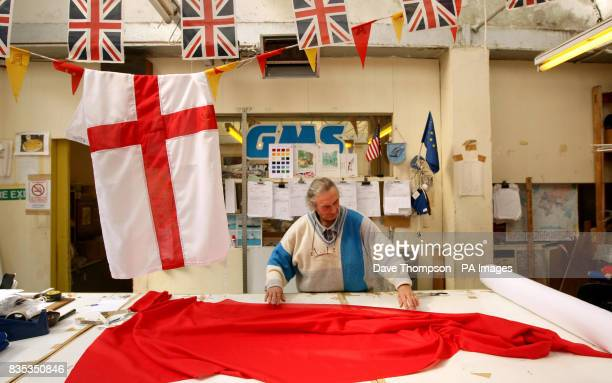 STANDALONE photo Senior Flagmaker Stuart Witham prepares a St George's flag at United Flags and Flagstaffs in Middleton Manchester before the St...
