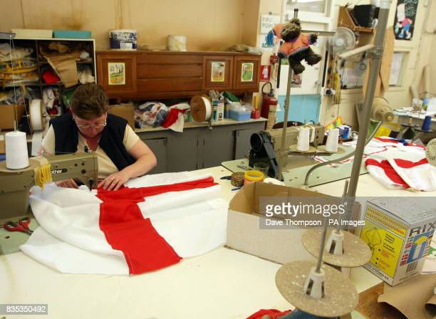 STANDALONE photo Senior seamstress Cath Caine makes a St George's flag at United Flags and Flagstaffs in Middleton Manchester before the St George's...
