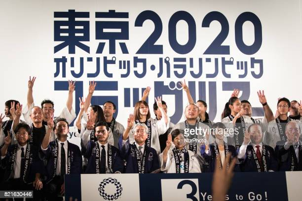Photo session on the stage with hosts guests Flag ambassadors representatives of Shizuoka Japanese athletes during the Tokyo 2020 flag tour festival...