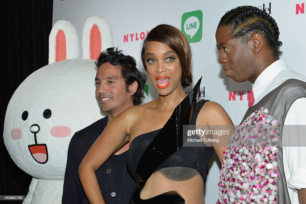 Photo shoot creative consultant Yu Tsai, supermodel <a gi-track='captionPersonalityLinkClicked' href=/galleries/search?phrase=Tyra+Banks&family=editorial&specificpeople=202216 ng-click='$event.stopPropagation()'>Tyra Banks</a> and 'America's Next Top Model judge <a gi-track='captionPersonalityLinkClicked' href=/galleries/search?phrase=J.+Alexander&family=editorial&specificpeople=698504 ng-click='$event.stopPropagation()'>J. Alexander</a> attend the premiere party for Cycle 21 of 'America's Next Top Model' presented by NYLON magazine and the LINE messaging app at SupperClub Los Angeles on August 20, 2014 in Los Angeles, California.
