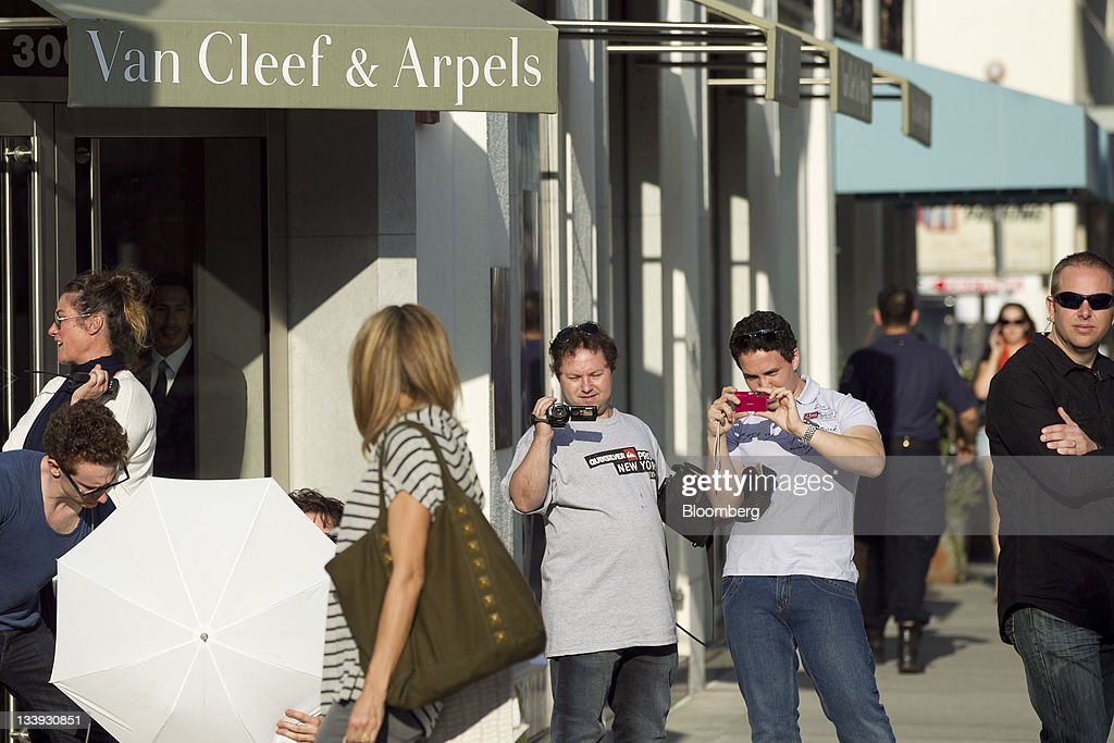 A photo shoot takes place in front of a Van Cleef & Arpels store on Rodeo Drive in Beverly Hills, California, U.S., on Thursday, Nov. 17, 2011. U.S. retail sales growth will slow to 2.8 percent during the holiday season this year, restrained by decelerating job growth, a weak housing market and a volatile stock market, the National Retail Federation said. Photographer: Andrew Harrer/Bloomberg via Getty Images