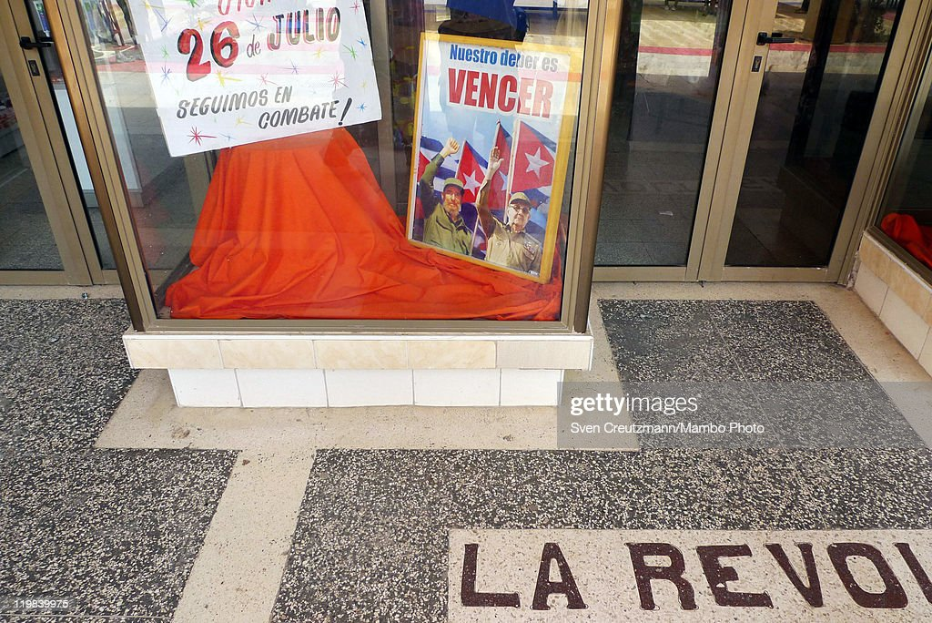 A photo showing Cuban Revolution leader Fidel Castro (L) and his brother Raul Castro, President of Cuba (R), is being displayed in a shop window, on July 25, 2011 in Ciego de Avila, Cuba. Cuba will celebrate the 58nd anniversary of the attack of the Moncada barracks in Santiago in 1953, with a political act in Ciego de Avila, in central Cuba. The attack was led by Revolution leader Fidel Castro and his brother Raul failed but in Cuba it is seen as the birth of the Cuban Revolution.