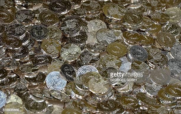 A photo shows 10euro coins on March 21 2016 at the Monnaie de Paris in Pessac western France The Monnaie de Paris will create two series of twelve...