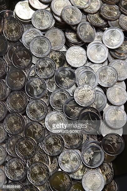 A photo shows 2euro coins on March 21 2016 at the Monnaie de Paris in Pessac western France The Monnaie de Paris will create two series of twelve...