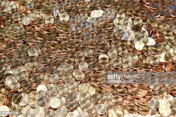 A photo shows 5euro coins on March 21 2016 at the Monnaie de Paris in Pessac western France The Monnaie de Paris will create two series of twelve...
