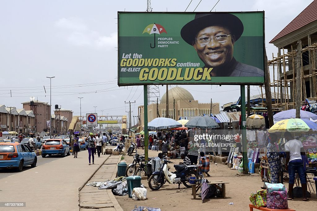 Photo shows a campaign billboard of Nigerian President <a gi-track='captionPersonalityLinkClicked' href=/galleries/search?phrase=Goodluck+Jonathan&family=editorial&specificpeople=4124968 ng-click='$event.stopPropagation()'>Goodluck Jonathan</a> and candidate of the ruling Peoples Democratic Party (PDP) in downtown Akure, Ondo State southwestern Nigeria, on March 23, 2015. Africa's most populous country and top economy, Nigeria, holds general elections on March 28 -- the fifth since civilian rule was restored in 1999. AFP PHOTO / PIUS UTOMI EKPEI