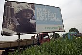 A photo shows a campaign signboad displayed by the ruling All Progressives Congress to show its readiness to defeat Boko Haram Islamists on...