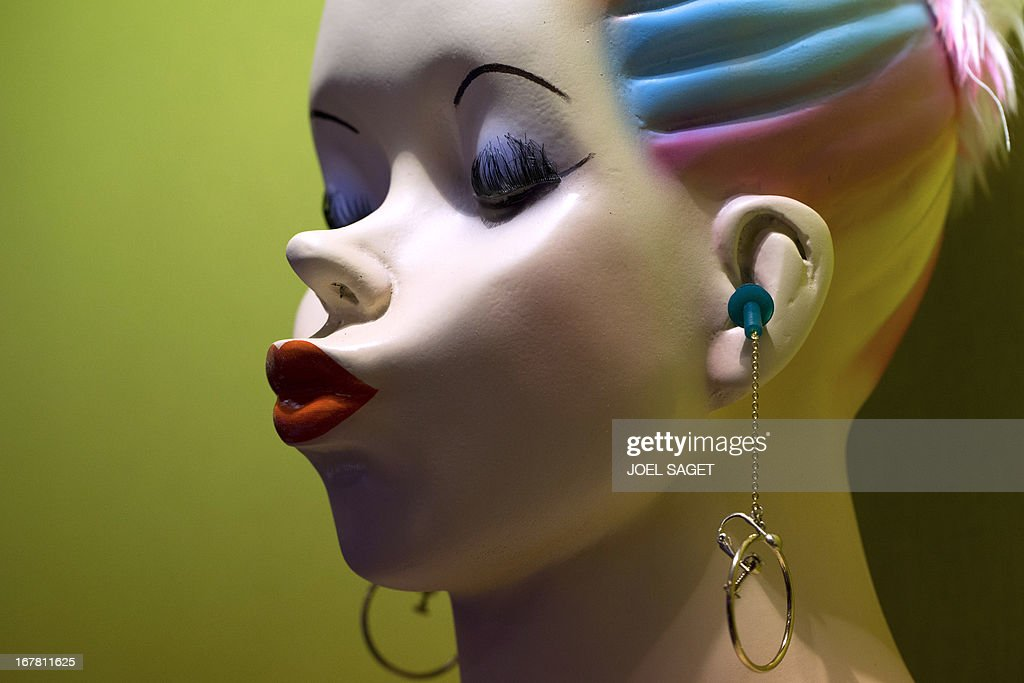 A photo shows a 'chindogu' earring with noise protection presented on April 30, 2013 during the 2013 Concours Lepine as part of Paris' Fair at the Porte de Versailles exhibition in Paris. The Concours Lepine is a French inventors' contest created in 1901. The word 'Chindogu' translates as 'weird tools' and refers to the founder of the International Chindogu Society, Kenji Kawakami, who has invented hundreds of bizzare and absurd items.